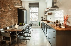 freshome.com- Galley Kitchen with brick wall