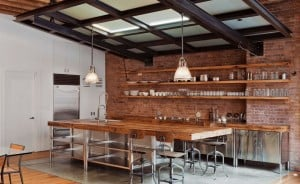 industrial like kitchen with large wooden island