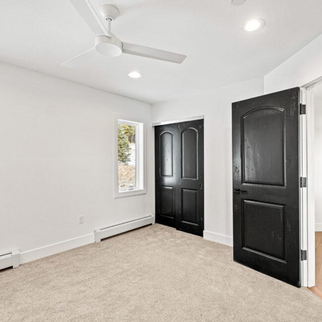 Custom Mountain Home - Empty Bedroom Leading to Hallway